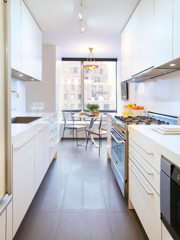 The all white galley contemporary kitchen with small dining space ideal for  small families and couples.