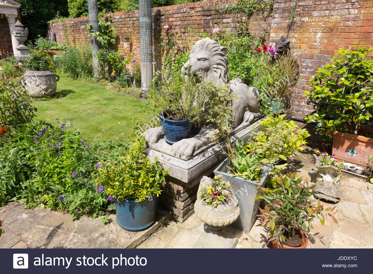 Large garden ornaments including lion statues and pots in an ornate english  garden, Kent England UK