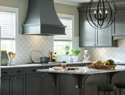 Kitchen with backsplash featuring tile shapes influenced by global trends.