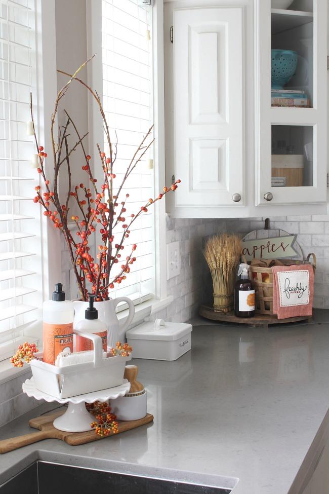 Fall kitchen decor ideas. Faux orange berries and orange dish soap add a  pop of