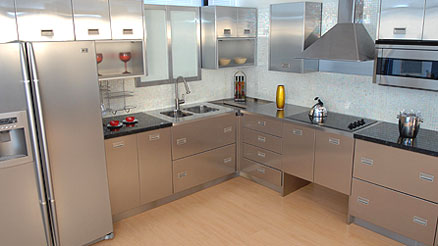 Metal kitchen cabinets and appliances made of stainless steel