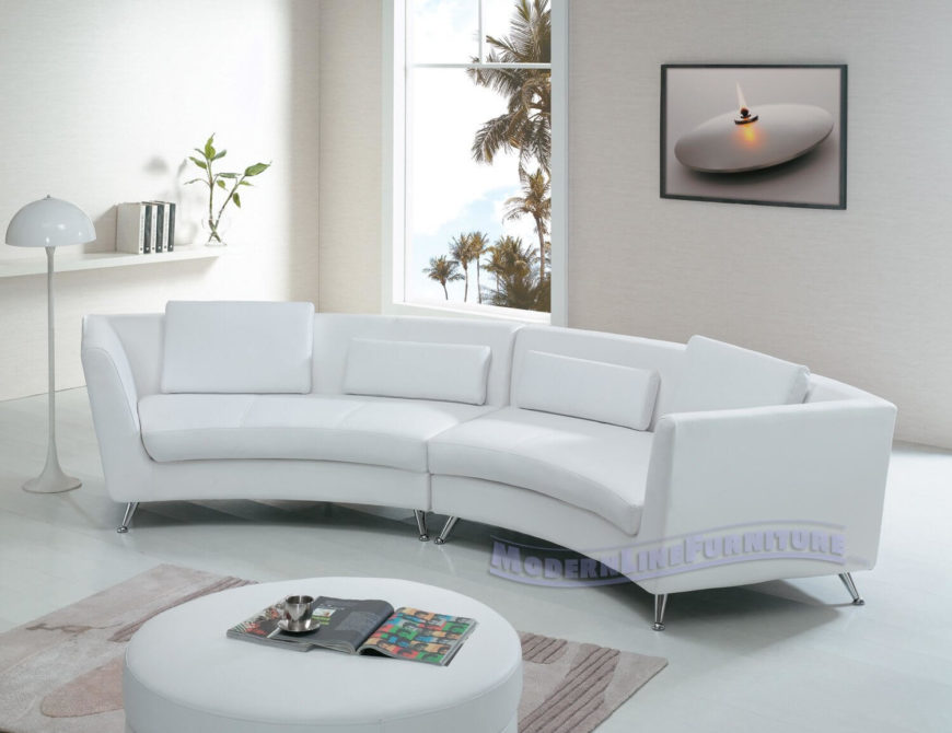 Sleek, modern design informs the look of this white leather two-piece.  Chromed .