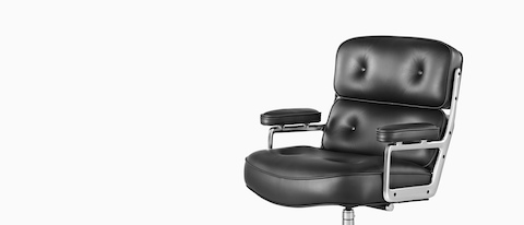 Black leather Eames Executive Chair, offering a close view of the thickly  cushioned seat,