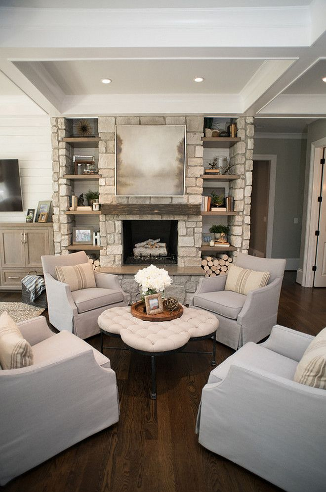 Living room Chairs. Four chairs together creates an inviting sitting area  by the fireplace. Living room chairs are Chairs are Azriel swivel glider  from Sam