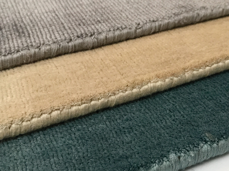 Handloomed rug samples made of viscose.