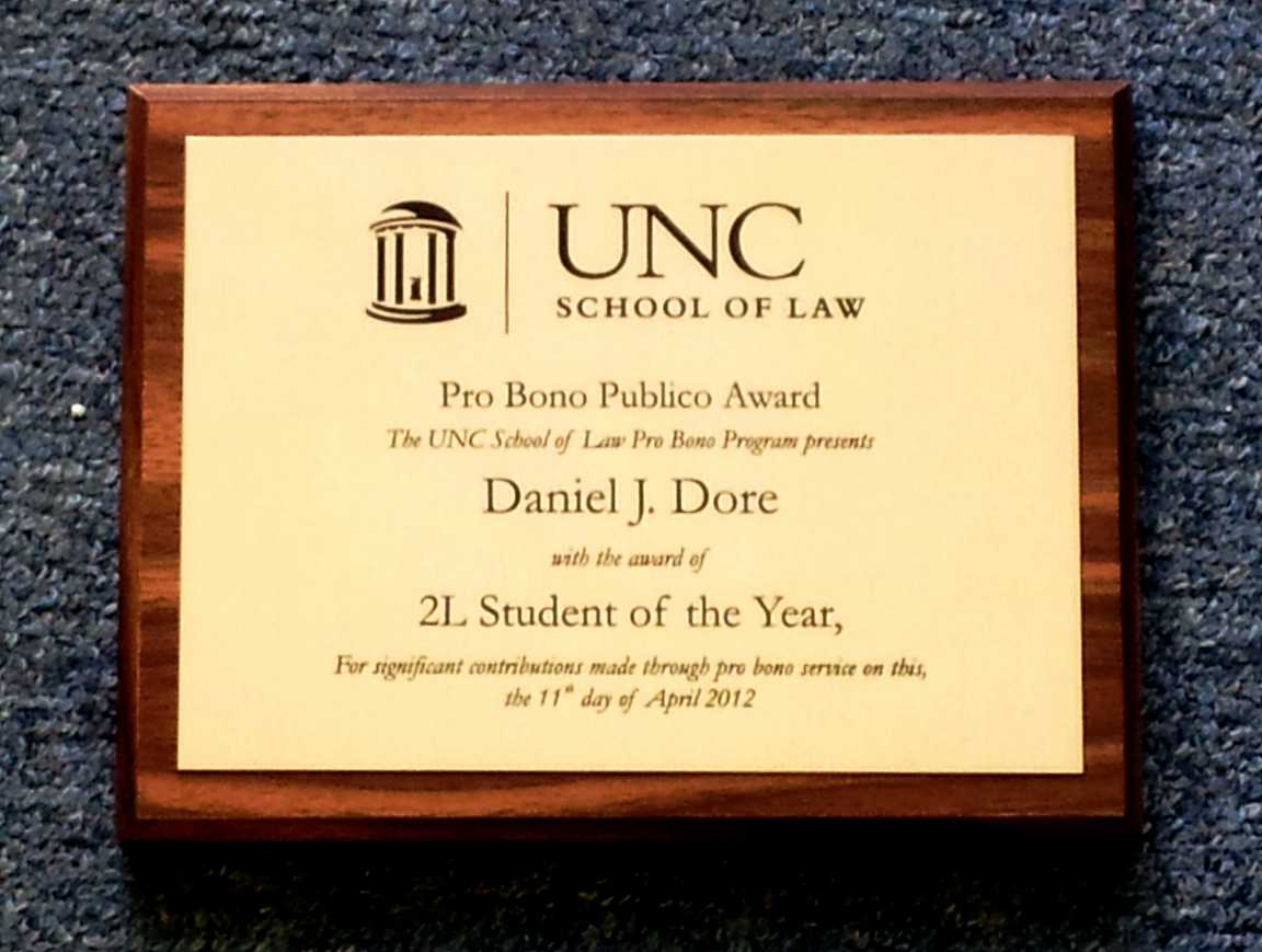 wall plaque brushed brass UNC Pro Bono