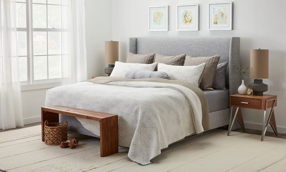 Arranging pillows on a bed HERO bedding accessories that you should have for a master bedroom