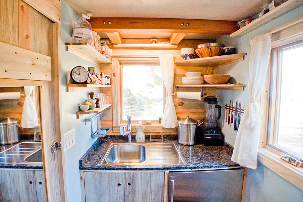 Tiny-House-Kitchen-by-The-Tiny-Project- Use corner shelves to make the most of your kitchen space