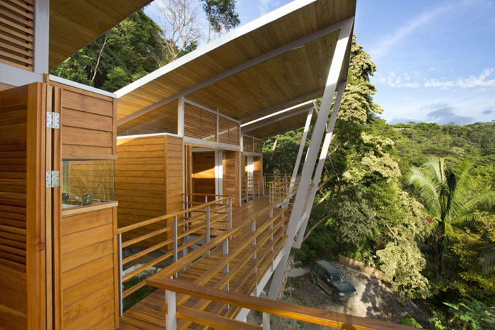 82975043359 Modern house with many wooden elements on the slope
