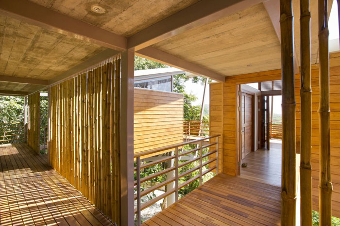 82975157599 Modern house with lots of wooden elements on the slope