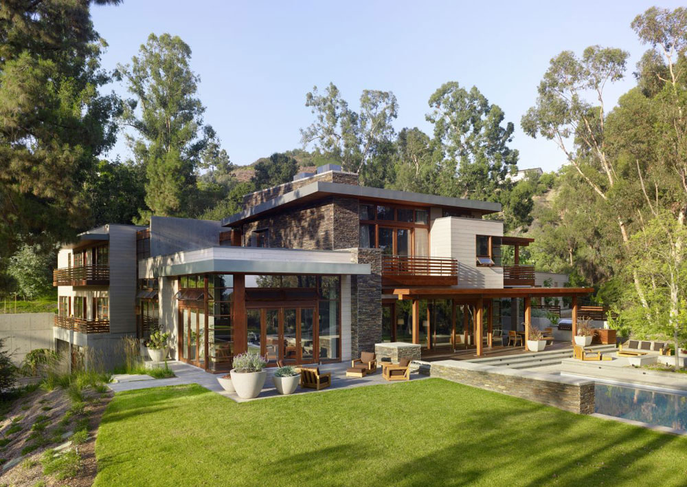Luxurious home surrounded by trees that complement its elegant furniture.  2 Luxurious home surrounded by trees that complement its elegant furniture