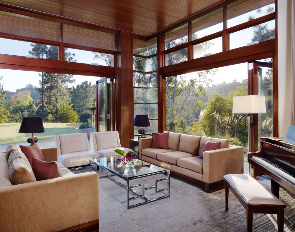 Luxurious home surrounded by trees that complement its elegant furniture.  7 Luxurious home surrounded by trees that compliment its elegant furniture