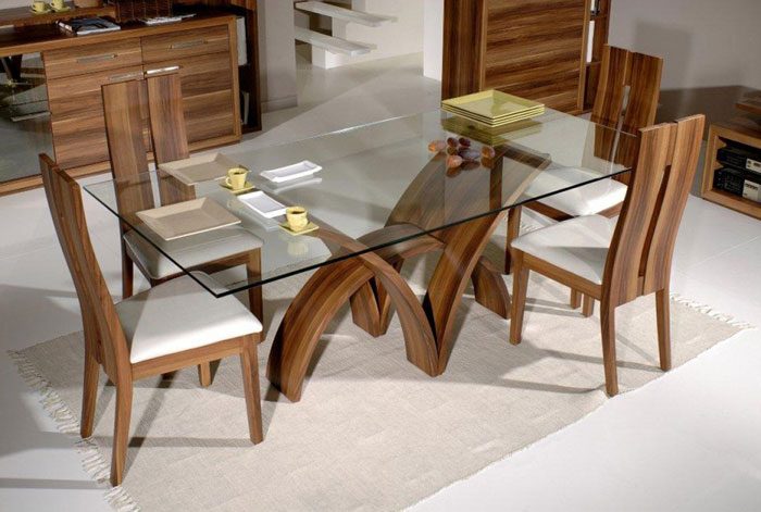 67958736143 Dining tables made of glass give your interior a contemporary touch