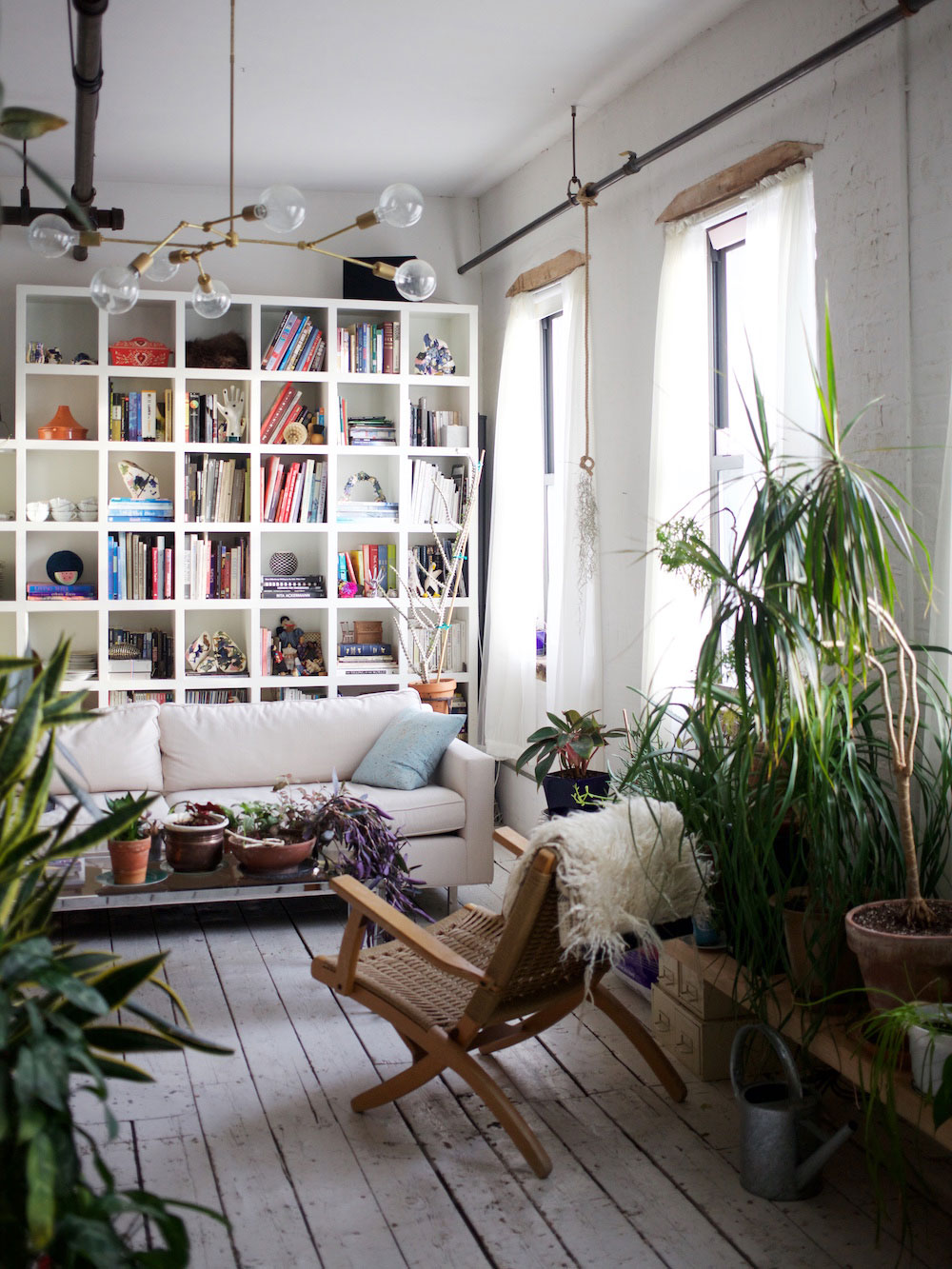 Brooklyn-houseplants-filled-loft-light-lounge-chair-bookcase Creative ideas for decorating with flowers