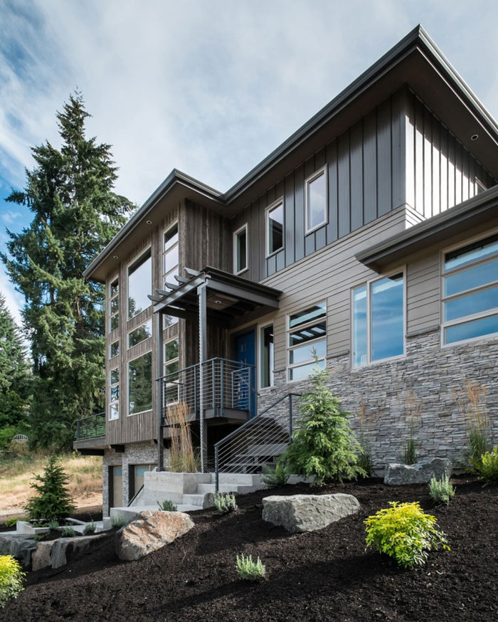 82285398265 House with natural stone and wood exterior and a high-end interior