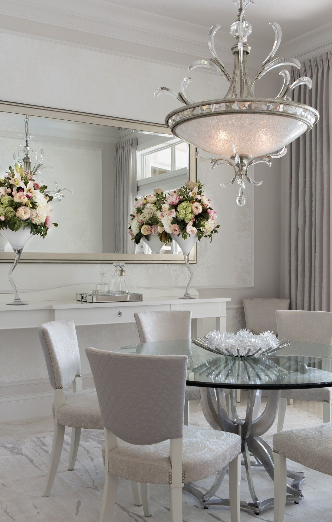 Glamorous dining room with chandeliers for the dining room